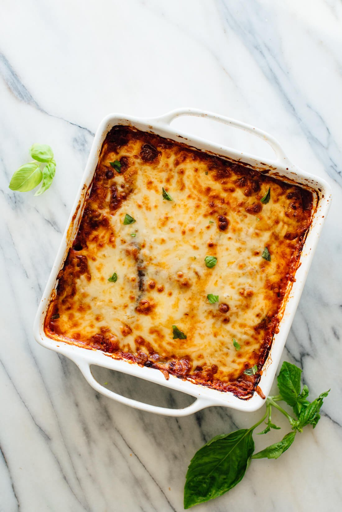 This gluten-free eggplant Parmesan recipe is easy to make. It's gluten-free because there's no breading involved in authentic Italian eggplant Parm! #glutenfree #vegetarian