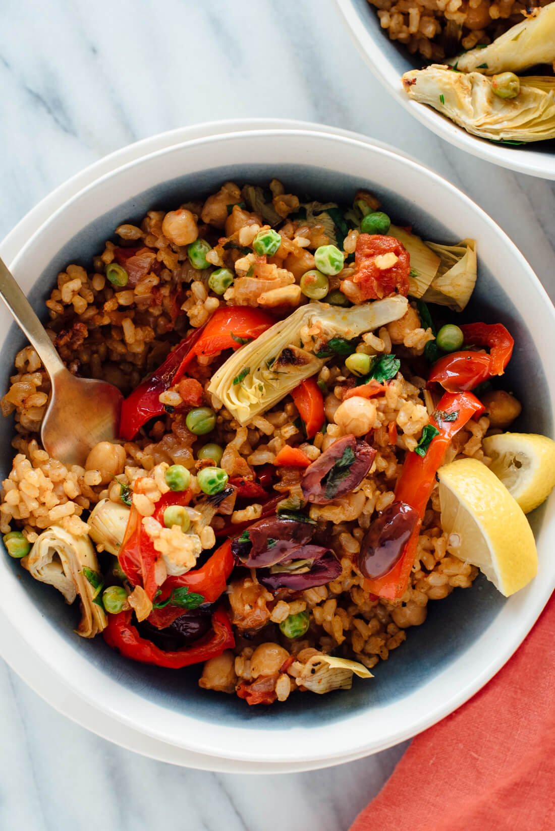 This vegetarian paella recipe is a veggie-packed twist on traditional Spanish paella!