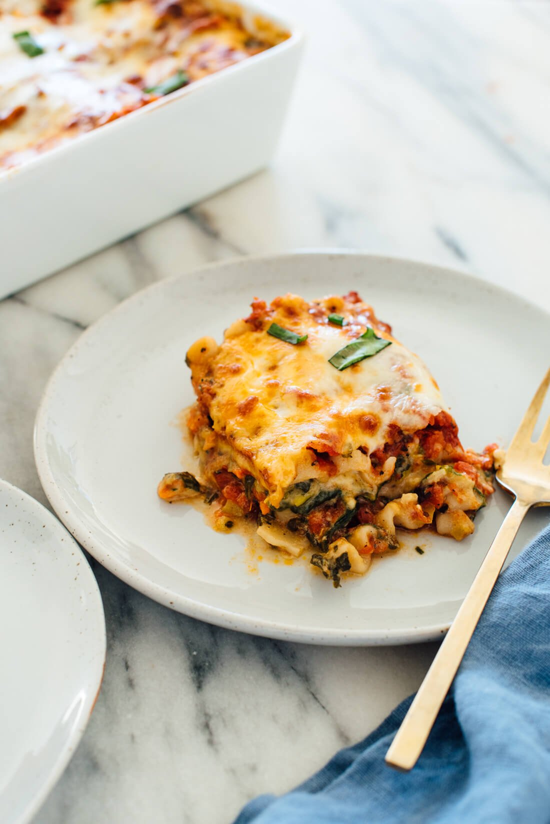 My favorite vegetable lasagna recipe, made with zucchini, bell pepper, carrots and spinach! No one will miss the meat in this #vegetarian #lasagna.