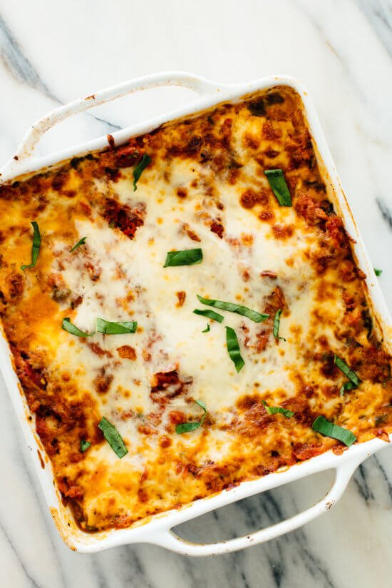 This amazing veggie lasagna recipe will please the carnivores in your life! It's cheesy, delicious and loaded with vegetables and spinach.