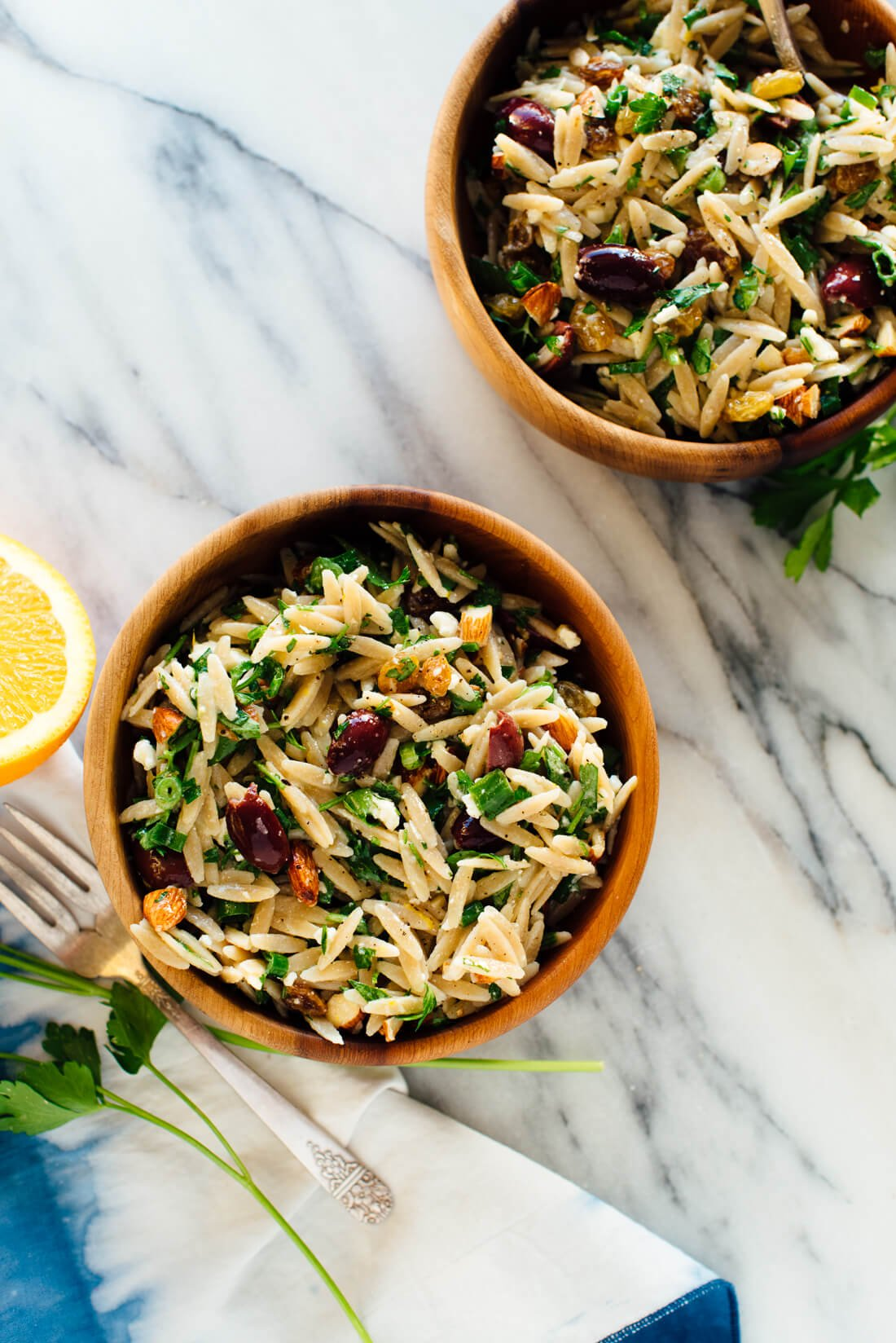 mediterranean orzo salad with orange parsley almonds in bowls