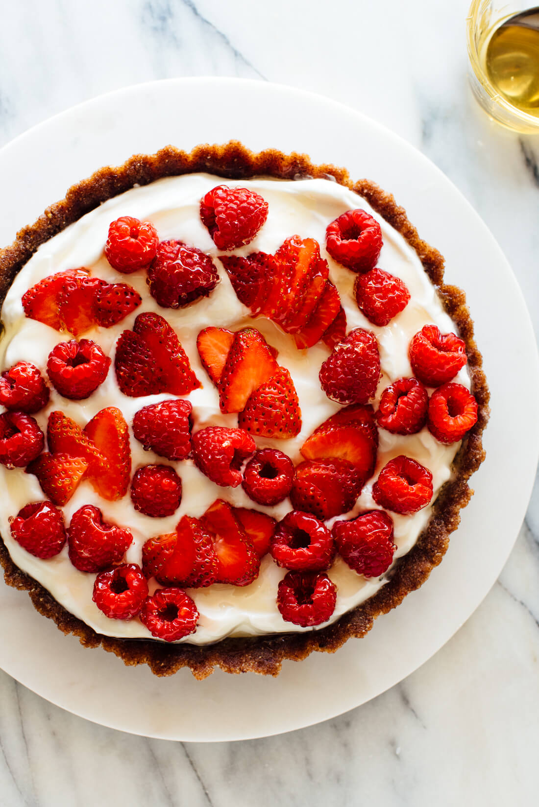 healthy greek yogurt tart topped with raspberries and strawberries