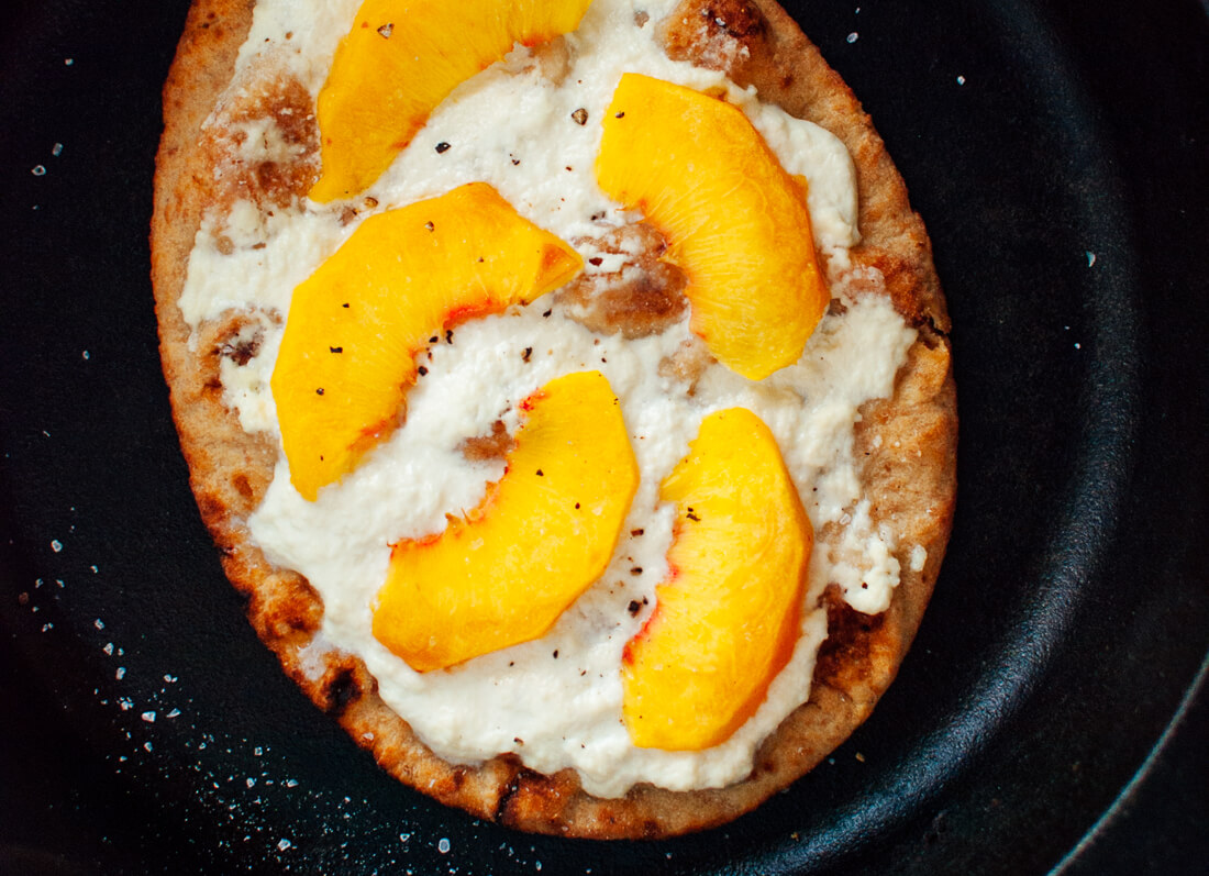 Simple Peach, Basil and Ricotta Flatbread in skillet