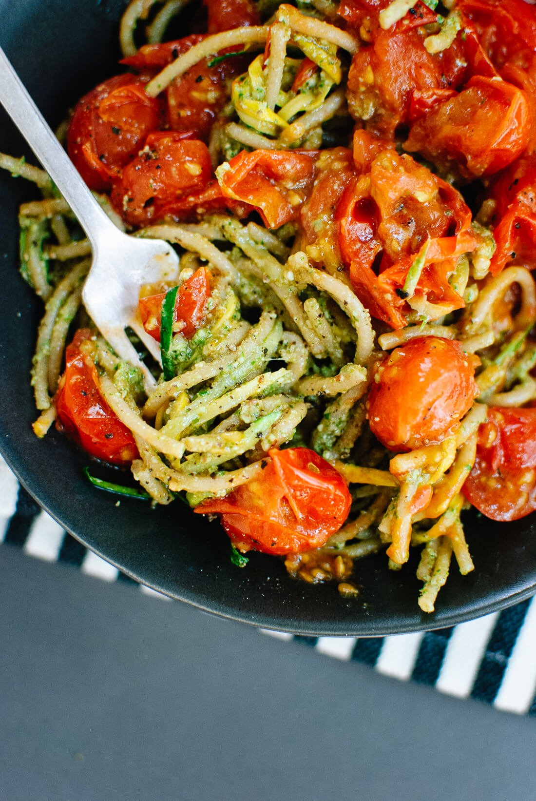 cherry tomatoes pesto squash noodles and spaghetti