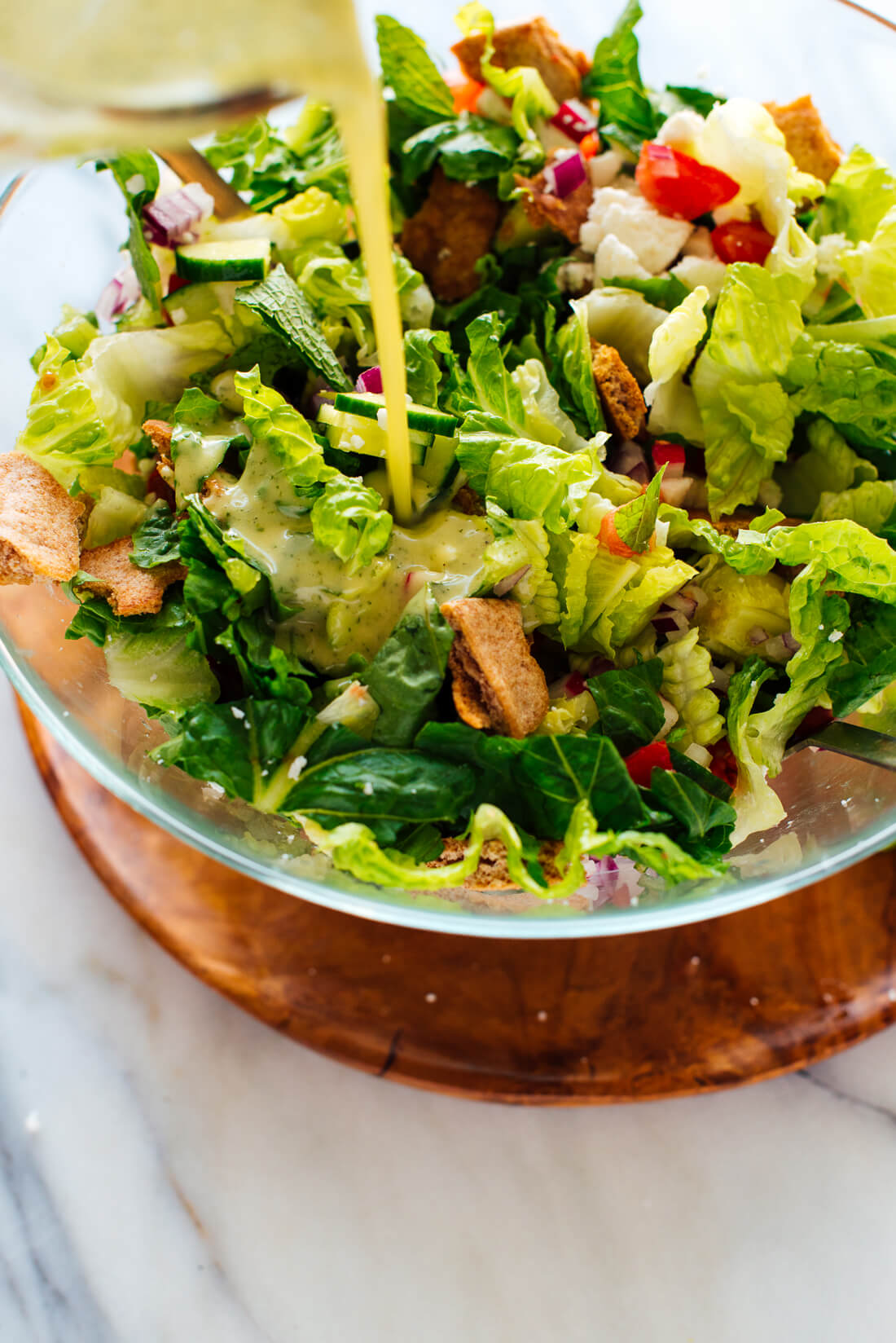 mint dressing over fattoush salad