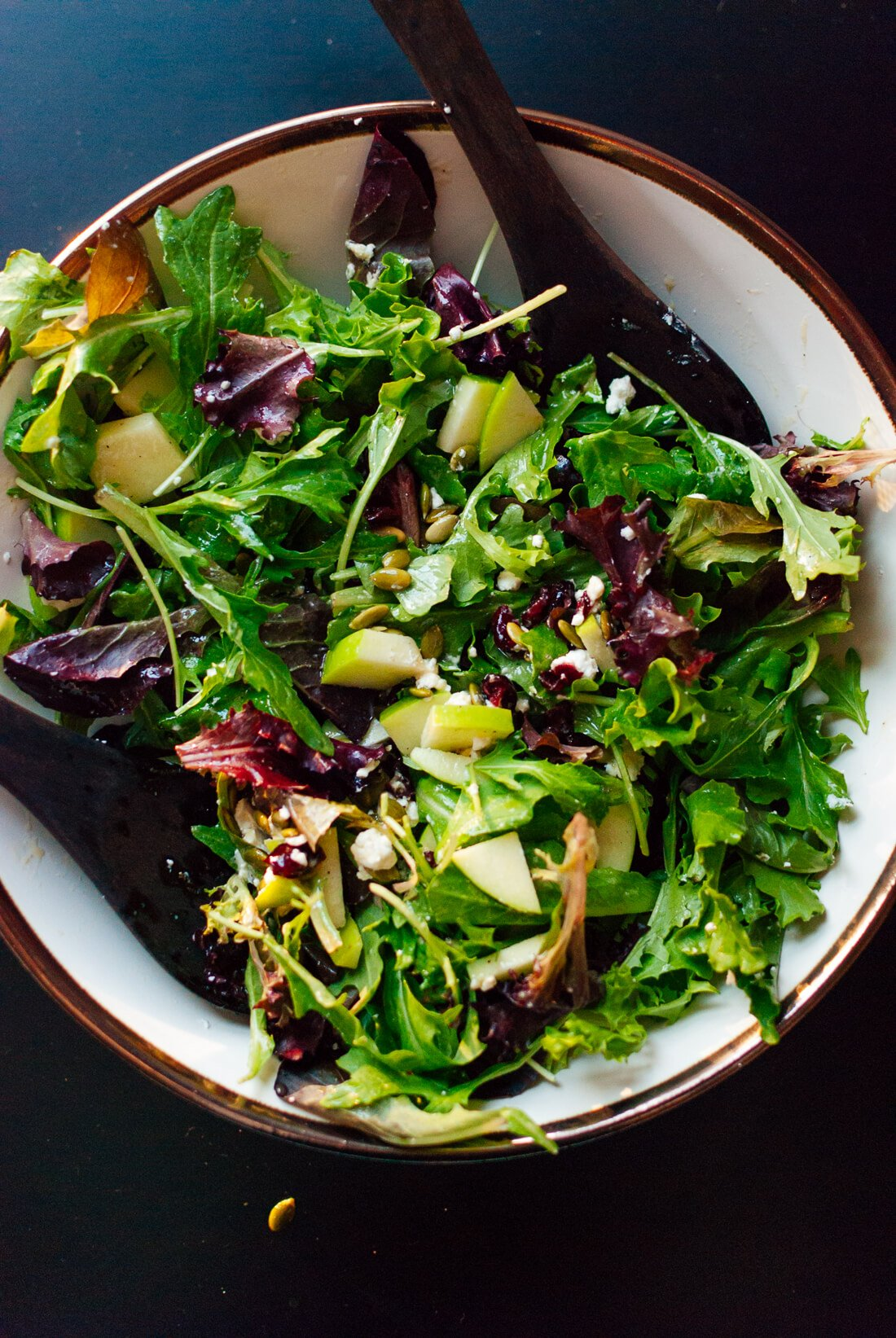 Green salad with apple, pepitas, cranberries and goat cheese