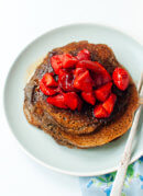 Gluten-free buckwheat pancakes with roasted strawberries on top