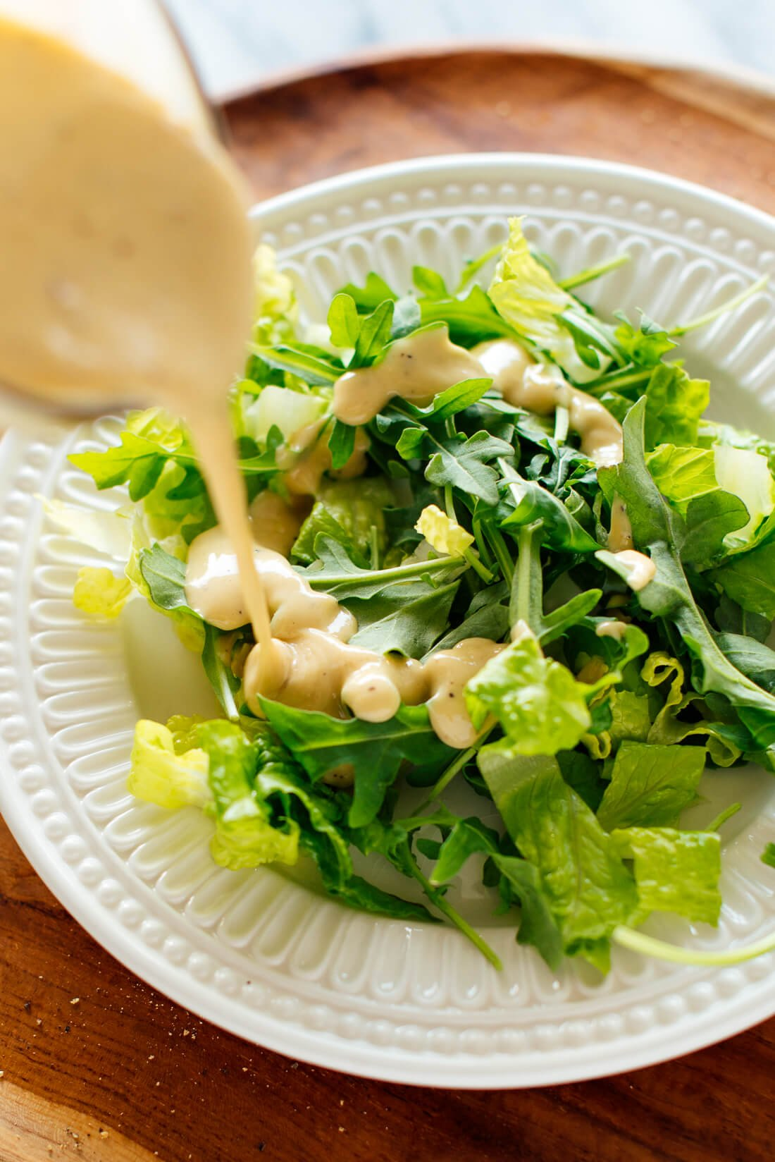 tahini dressing drizzled on salad