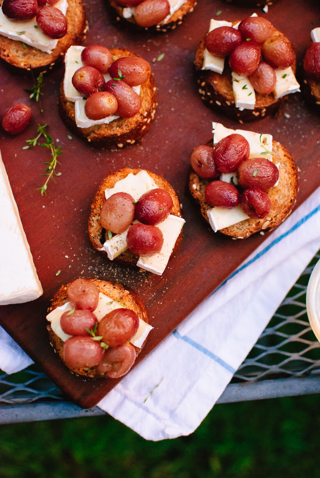 Jammy roasted grapes on brie and toast make a simple, seasonal appetizer!