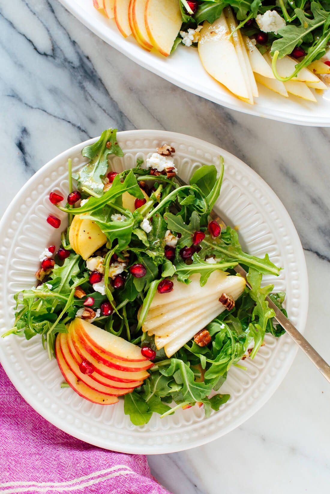 pomegranate pear arugula salad on plate