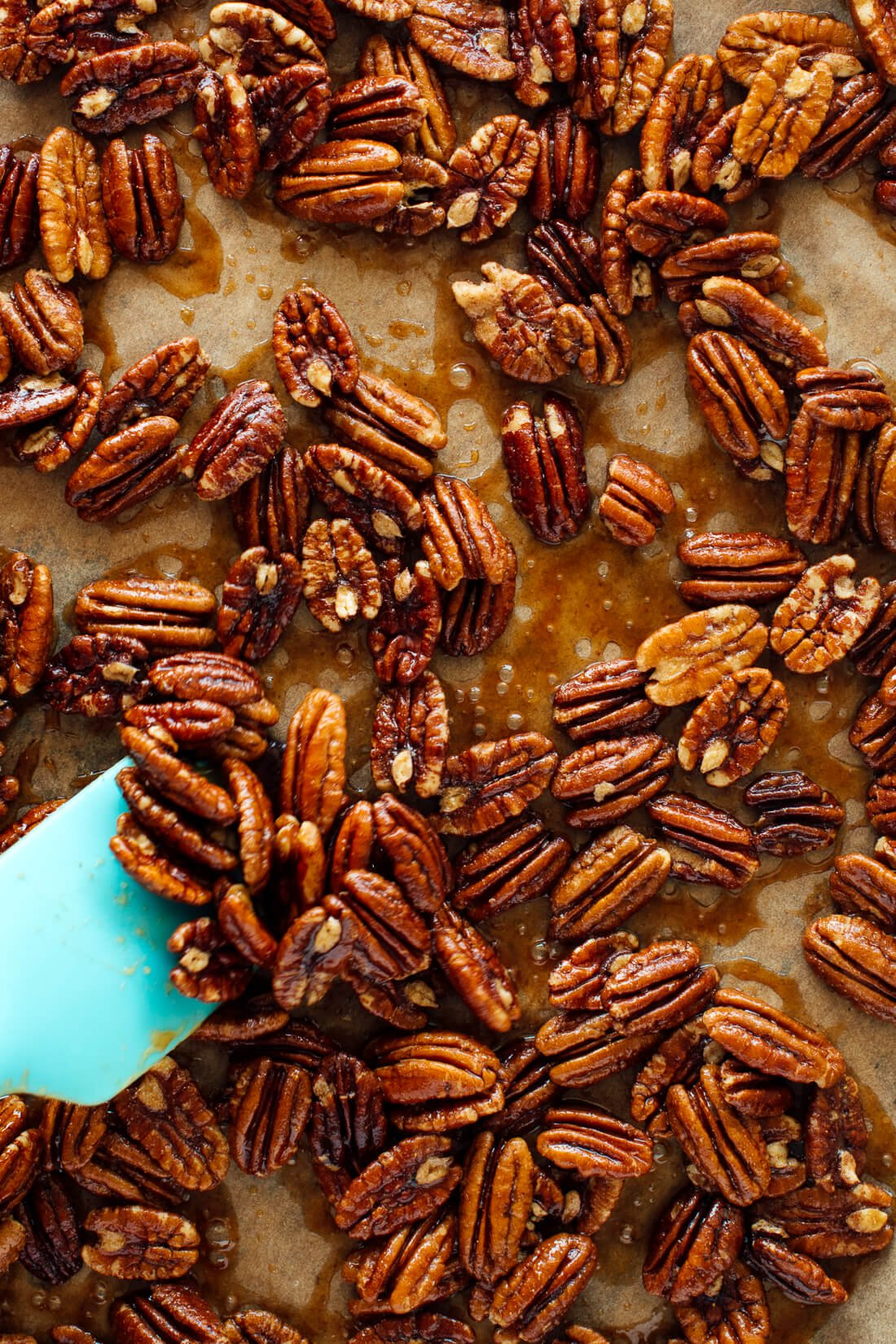 stirring maple candied pecans