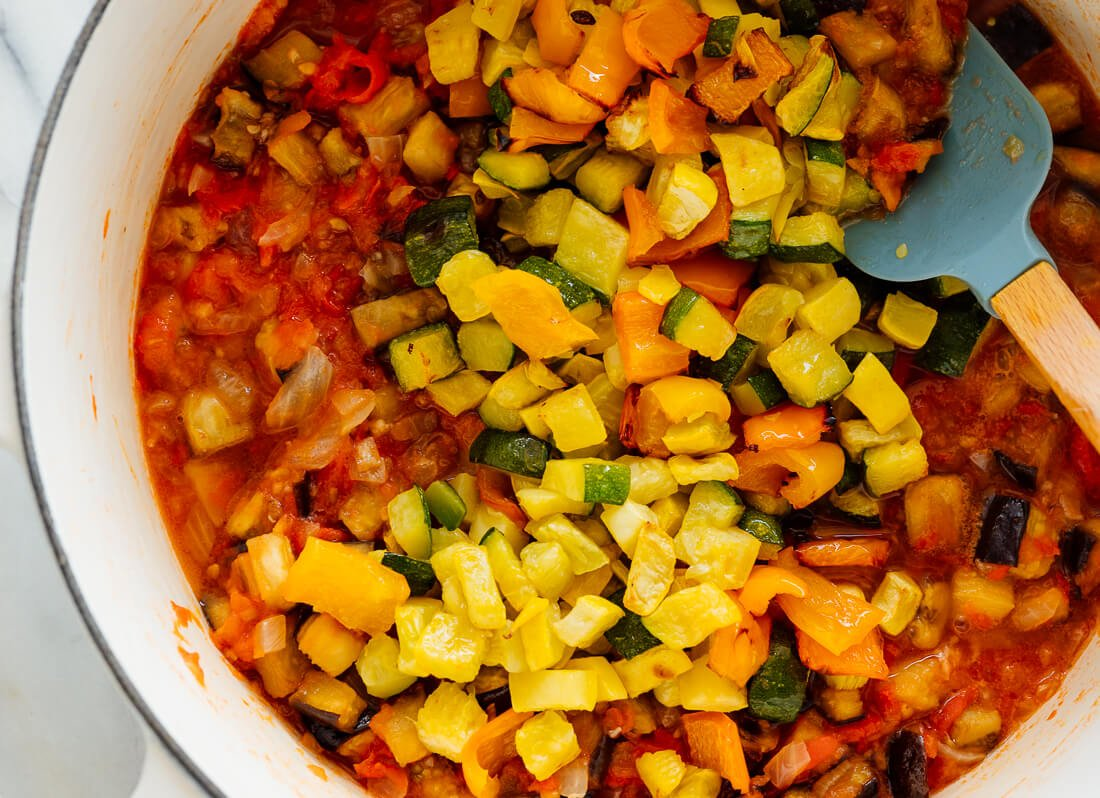 adding roasted squash to ratatouille