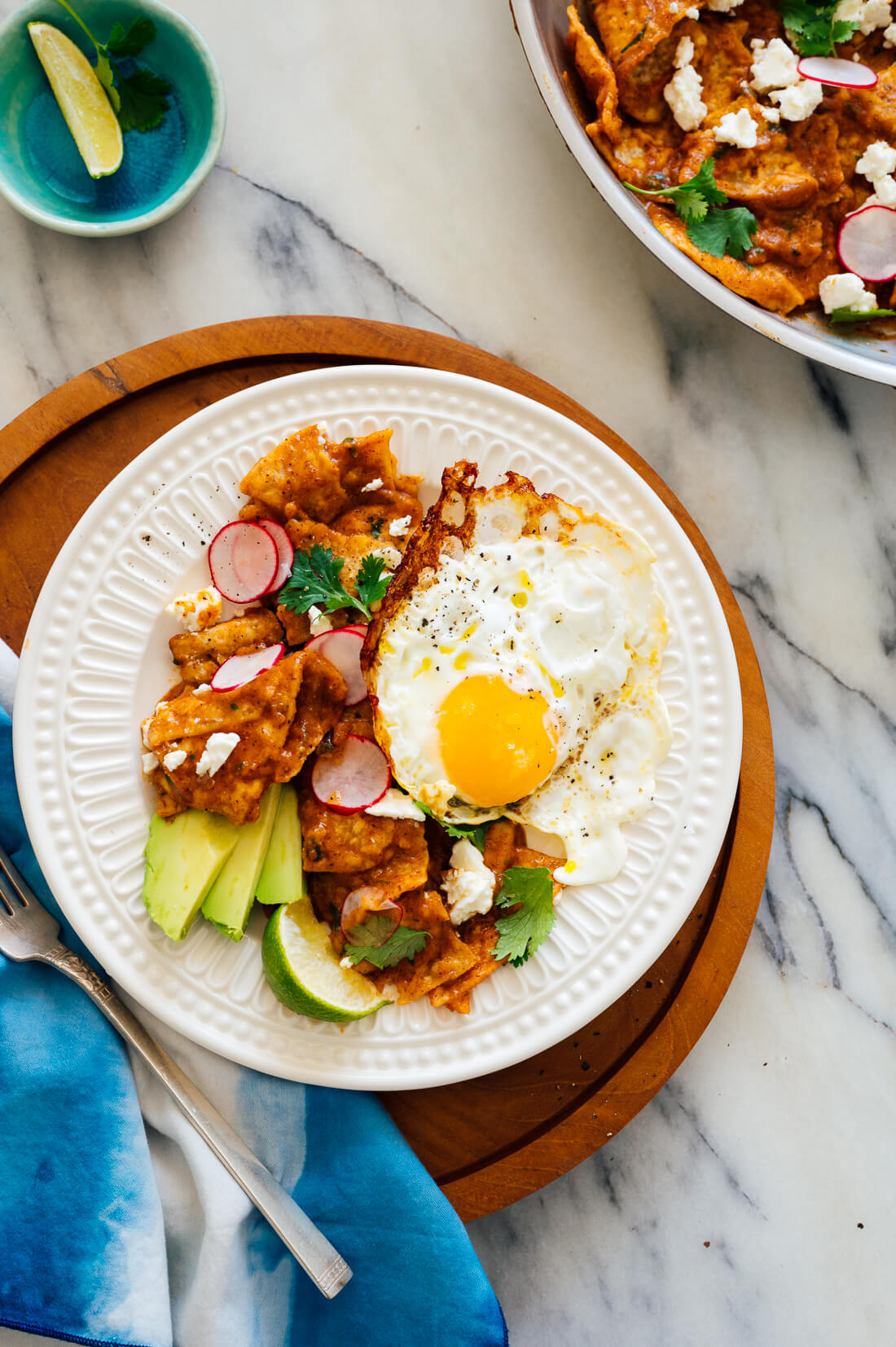 red chilaquiles recipe with fried egg and avocado