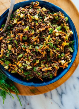 tangy lentil salad in blue bowl