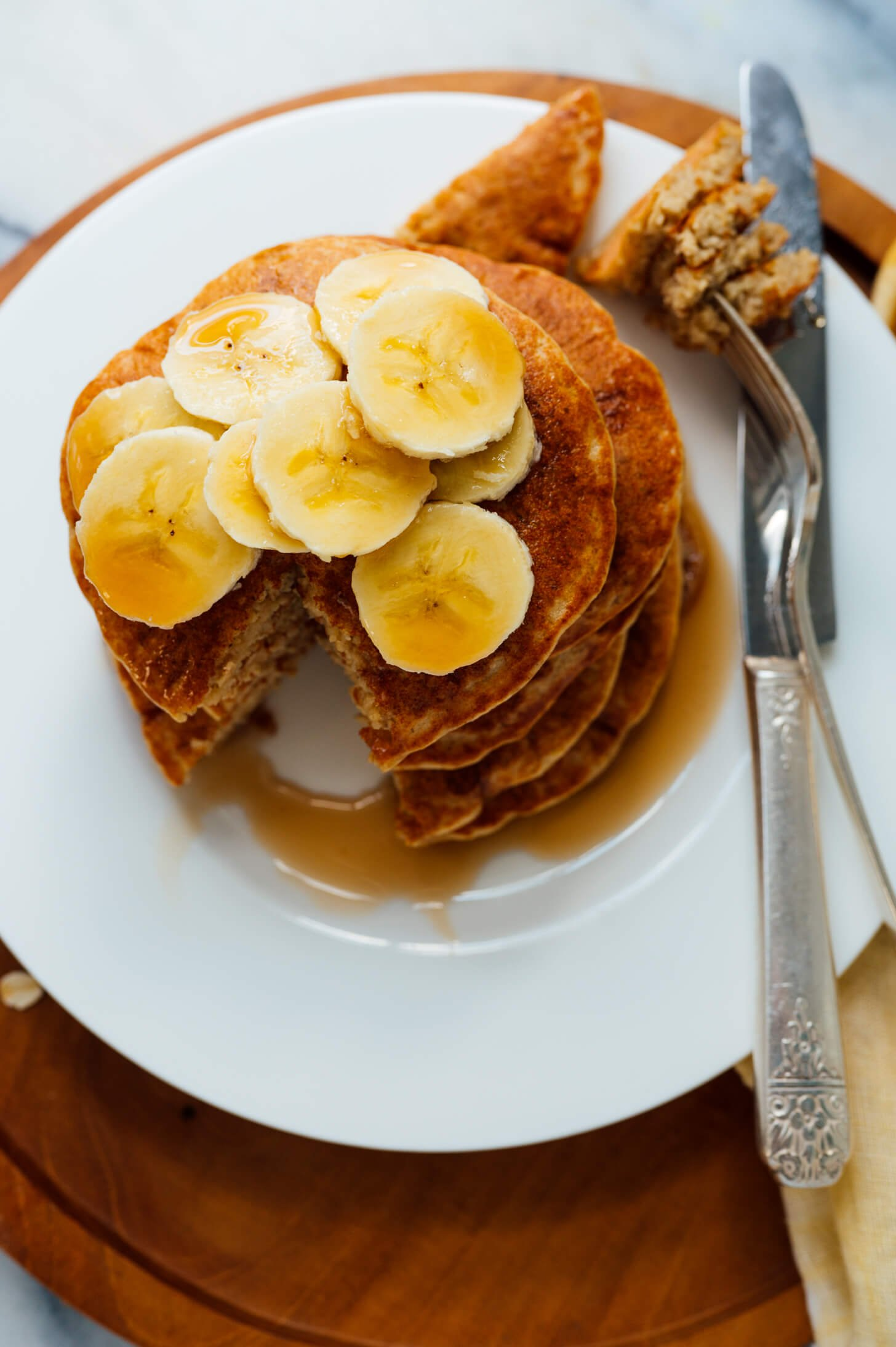 blender oatmeal pancakes with bananas on top